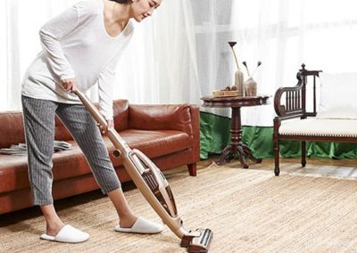 vacuuming carpet - cleaning floors